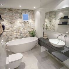 Beautiful neutral stone bathroom.