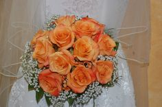 Bride's bouquet of orange roses with a collar of gypsophila. Helen Blakey Flowers, 2013 wedding flowers, Toronto wedding.