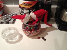 Our elf, Scout, in the Skittles.