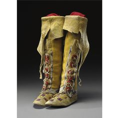 A PAIR OF SOUTHERN ARAPAHO WOMAN'S BEADED HIDE HIGH TOP MOCCASINS cloth, and sinew.  Height 16 1/2 in.
