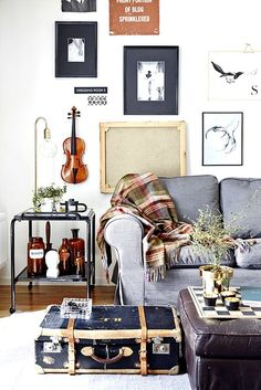 Living room with wall of pictures.  Stylist: Katrin Bååth. Photographer: Sara Landstedt.