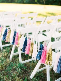 Tissue Paper Tassels along the aisle for a wedding ceremony- great idea! See more: http://theeld.com/1ydsPeD