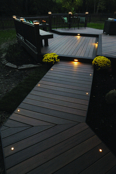 Home Remodel Exterior This more modern outdoor lighting makes a wood finish patio in a shabby chic garden look elegant.Home Remodel Exterior This more modern outdoor lighting makes a wood finish patio in a shabby chic garden look elegant. Outside House Decor, Timbertech Decking, Trex Decking, Wpc Decking, Patio Deck Designs, Deck Patio, Back Yard Design, Decking Area, Porch Designs