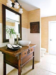 Classic white fixtures, timeless subway tile, earthy textures, and lots of light give this bathroom a unique east-meets-west vibe: http://www.bhg.com/bathroom/small/smart--stylish-small-bathroom-designs/?socsrc=bhgpin052414stylishrevamp&page=7