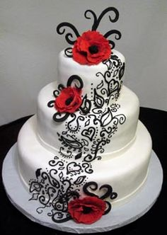 Katana Cakes - Wedding Cake with black accents, red flowers and a three tiers of white base frosting.