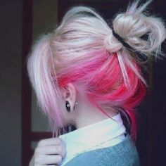 A Touch Of Pink. Part hair underneath. Dye selected hair underneath pink. Tip: Pony tails compliment pink, if you have brunette hair bleach underneath first.