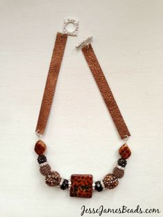 Saddle up, nice and easy!  Jesse James Beads and Tierra Cast leather designed by Candie Cooper