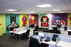 office workers install 8-bit superhero wall with 8,024 sticky notes