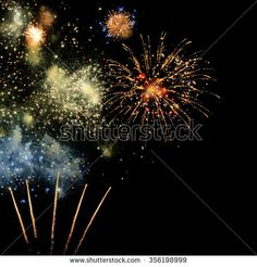Colorful fireworks in the black night sky; New Year's Eve; Party time