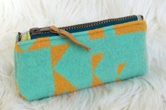 Festive Turqouise & Yellow Geometric Wool Zippered Pouch, Clutch. $17.50, via Etsy.