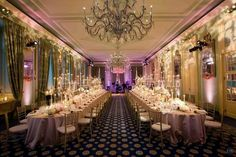 Pink up lighting and ornate stenciling on the walls transforms this hall