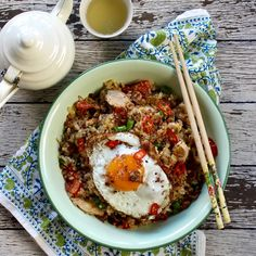 BROWN RICE NASI GORENG. We've given this Indonesian staple a healthy makeover. Made with brown rice, free range chicken breasts, beans, wombok (Chinese cabbage), tomato and spring onion topped with a fried free range egg. 30 Minutes. Free Range.