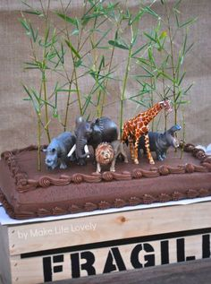 Adorable jungle safari animals birthday party cake using a store-bought cake. Easy and no baking involved!