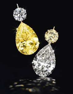 Another highlight of the auction was a pair of pear-shaped fancy yellow and colorless diamond ear pendants (below), of 52.78 and 50.31 carats, which sold for $ 4.6 million to Essex Global Trading, Inc.