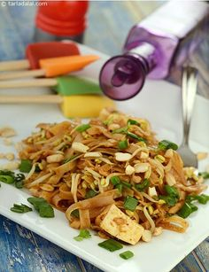 Phad Thai Noodles,these flat rice noodles are cooked and tossed with paneer, spring onion, bean sprouts, peanuts, garlic and other spices.