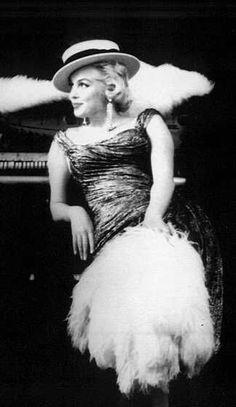 Marilyn. Maurice Chevalier sitting. Photo by Milton Greene, 1955.