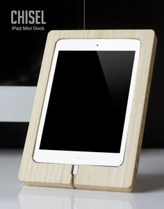 This handmade wooden iPad Mini Dock even accounts for the cord.