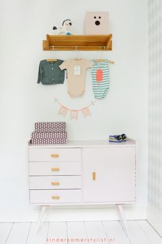 Cute changing table styling in a nursery