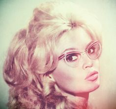 Bardot. With glasses.