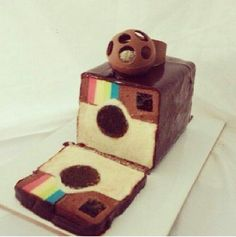 Hidden surprise inside cake design showing Instagram camera theme with chocolate
