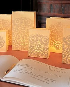 DIY- Give the decorations at your wedding reception the romantic look of lace. The intricate patterns shining through these luminarias (paper-bag lanterns illuminated by votive candles) are courtesy of doilies glued inside.  This would be awesome in the windows and throughout the food area/ tables.