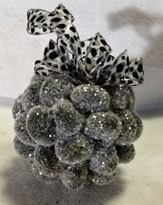 Textured ornament with black undertones irridescent glitter and snow leopard bow