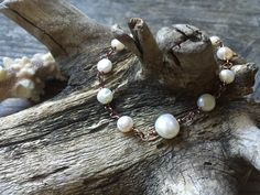 A personal favorite from my Etsy shop https://www.etsy.com/listing/290724969/white-pearl-linked-bracelet-in-antique