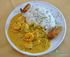 Typical Dish from Ecuador: Encocado de Camarones - Prawns in coconut milk sauce, often served with rice on the side.