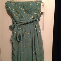 BCBGMaxazria Dress- price is negotiable. Strapless, sea foam green with gold, belted, tulip hem BCBGMaxAzria Dresses Strapless