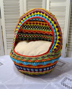 Crochet Cat Cave Pet Bed Upcycled Wicker Basket  Mulitcolor Boho Handmade Littlestsister by LittlestSister on Etsy https://www.etsy.com/listing/247042138/crochet-cat-cave-pet-bed-upcycled-wicker