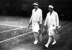 Tennis players Helen Wills-Moody and Helen Jacobs walking onto the court at Wimbledon in 1929.
