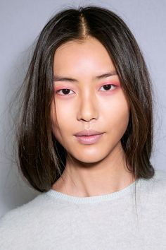 "Burberry Prorsum by Wendy Rowe.  ""Eggplant"" sheer eyeshadow on the eyes, sheer lip gloss, peony pink blush.  Neat idea."