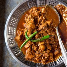 Chicken Vindaloo  This tangy, spicy curry from Goa, India, has roots in vinh d'alho, a stew brought to the region by Portuguese colonists. Now an Indian restaurant staple, it comes in countless variations—some fiery, some mild—from the subcontinent to the British Isles.