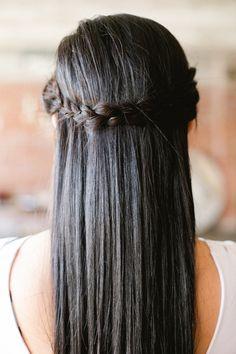 straight hair with a braided twist, photo by Amanda Watson http://ruffledblog.com/mixed-metals-summer-wedding-inspiration #weddinghair #hairideas