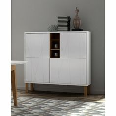Niche Cupboard with Oak Legs - Simple yet functional, the Niche Cupboard with Oak Legs boasts clean sleek lines and plenty of storage space. A Shelf, Shelves, Cupboard, Cabinet, Modern Sideboard, Storage Spaces, Innovation, Living Spaces, The Unit