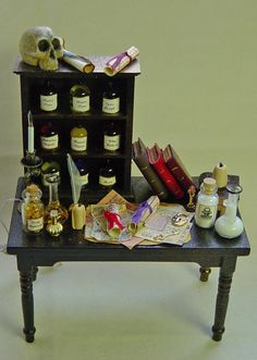 Dolls house Miniature Filled Table  APOTHECARY/  POISONER'S PARADISE. £38.00, via Etsy.