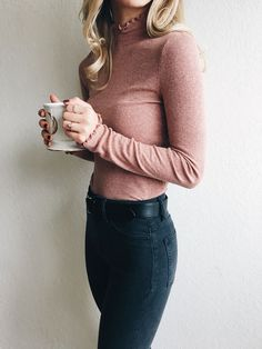 blush top and dark jeans
