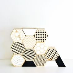 Monochrome hexagon stacking blocks wooden toy. Perhaps a material or inspirational idea for my reception desk. I do want it to be fun for the kids and for people who arrive.