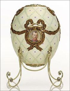 ORDER OF ST. GEORGE EGG,1916.Presented by Tsar Nicholas II to the Dowager Empress Maria Feodorovna on Easter 1916, the egg commemorates the 1915 presentation of the Order of St. George.The Order was created by Catherine the Great to be bestowed by members of the army for military bravery. Nicholas was presented with the highest class of the Order for his leadership during WWI.His son, Alexis, received a lower grade.When a button is pressed, miniatures of the honored recipients are revealed.