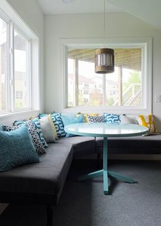 upholstered banquette with DIY ikea mattresses as cushions. Ikea Pendant Light, Pendant Lights, Brass Pendant, Turquoise Pillows, Blue Pillows, Bright Pillows, Built In Bench, Upholstered Bench, My Living Room