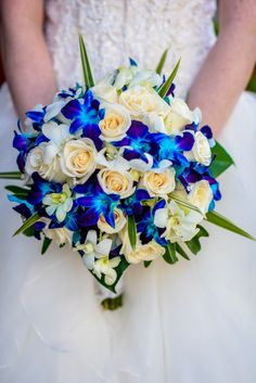 Mix blue hues with white roses for a bouquet that will turn heads down the aisle