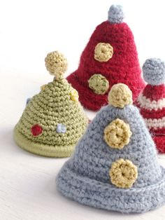 Crochet hats on Fournier's collection of toys & pillows