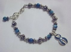 Teal awareness bracelet for PTSD, food allergies, and more.