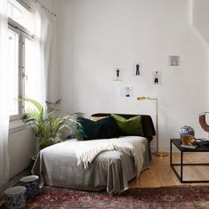 studio apartment decorating \ green pillows More