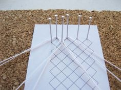 """A """"ground"""" in bobbin lace is just a way of filling space with a mesh or net. There are a lot of different grounds, but the whole stitch/torchon is a very common one. It can either be used as a filler between other design elements or as a lace by itself (as I'm showing it Read More"""