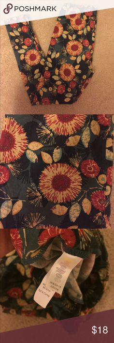 Tall and Curvy LulaRoe floral leggings A gorgeous teal floral pattern on tall and Curvy LulaRoe leggings. Worn only once- EXCELLENT CONDITION! LuLaRoe Pants Leggings