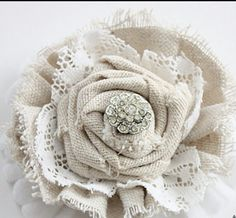 I like this, but maybe would like the center flower to be made of muslin and only use burlap for the bottom part.