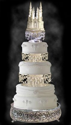 Weddbook is a content discovery engine mostly specialized on wedding concept. You can collect images, videos or articles you discovered organize them, add your own ideas to your collections and share with other people | Cinderella Castle Royal Wedding Cake - My wedding ideas