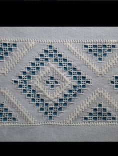 Ukrainian Cutwork. Typical with the cross at the outer intersections of the cutouts.