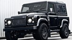 The Land Rover Defender has rugged good looks, a storied legacy and tons of  street credit.  English tuner Kahn Design has turned its attention towards  this iconic truck. Starting with the 1983 model, designer Afzal Kahn has  gone with a wide-body kit with extended wheel arches and introduced me